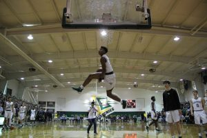 Jalen rises for an easy dunk during warm-ups.